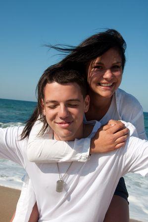 offset angle: Couple having fun on the beach Stock Photo