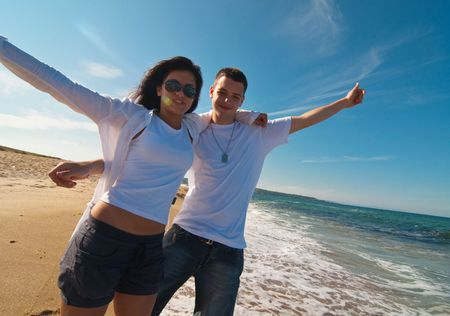 Couple having fun on the beach Stok Fotoğraf