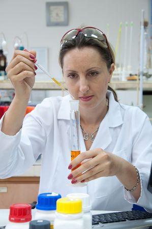 chemist pipetting photo
