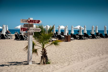Wooden signboard from four arrows on the beach photo