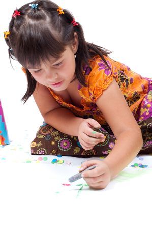 chalks: girl laying and drawing with chalks on ground