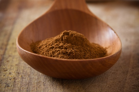 Cinnamon in a pile of wooden spoon
