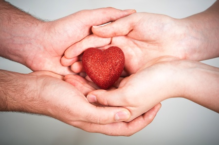give hand: red heart in hands