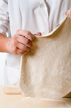 woman hands knead dough