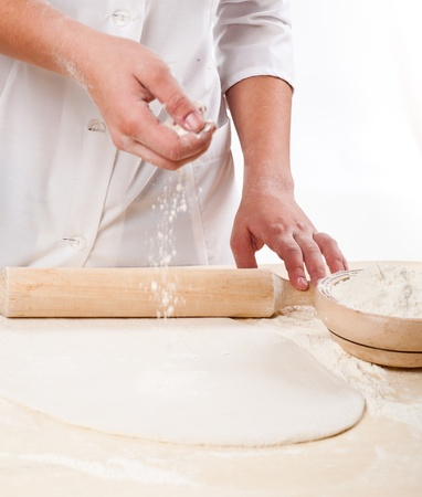 woman hands knead dough photo