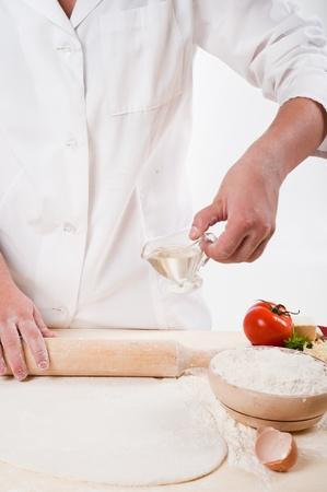 woman hands knead dough Stock Photo - 10627785