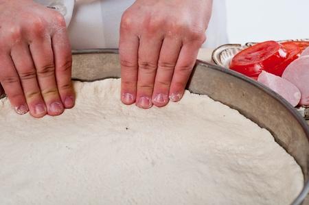 woman hands knead dough  photo