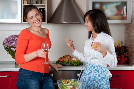 two young woman preparing food  photo