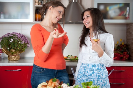 two young womеn preparing food  photo