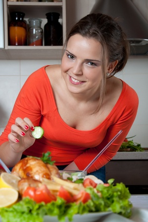 young woman preparing food  photo