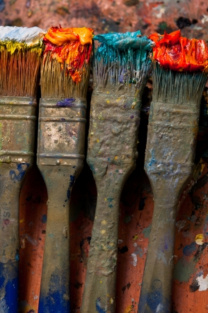 Paintbrush with oil paint on a classical palette photo