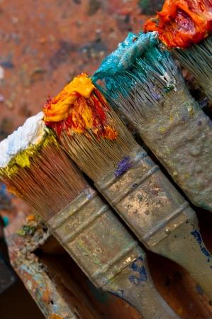 paint palette: Paintbrush with oil paint on a classical palette