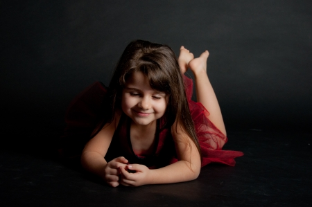 cute little girl dancing in red dress Stock Photo