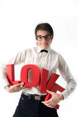 parting: smiling young man holds a large red letters love Stock Photo