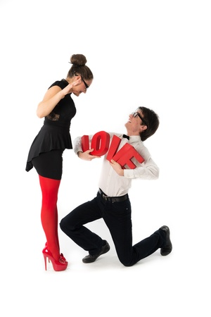 women s legs: A funny young couple  Nerd,holding red love letters