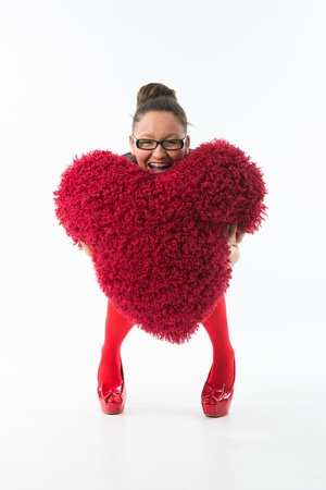 women s fashion: smiling young woman holds a large hairy red heart