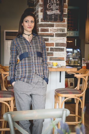 caffee: Young woman in modern clothes in trendy restaurant , caffee Stock Photo