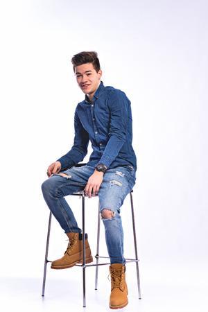 casual men: Male model in denim jeans . Studio shoot. Stock Photo