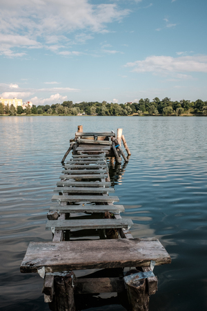fishing pier: Summer blue lake with a small old fishing pier