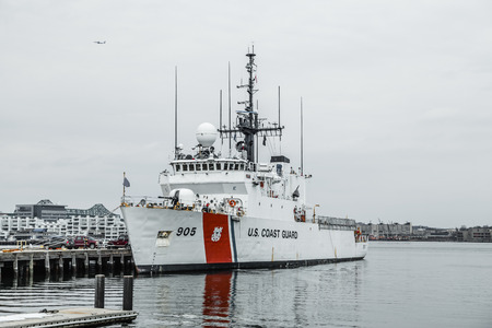 aegis: Boston, MA, USA - March 2, 2014: Ships of The US Coast Guard docked at Base Boston on cloudy day Editorial