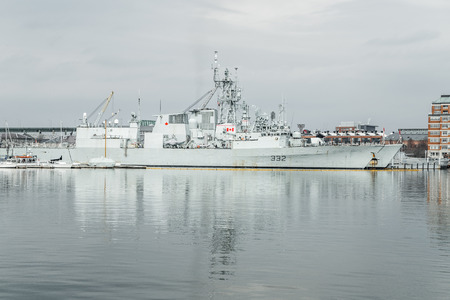 aegis: Boston, MA, USA - March 2, 2014: Canada Navy ship docked at the US Coast Guard Base Boston on cloudy day Editorial