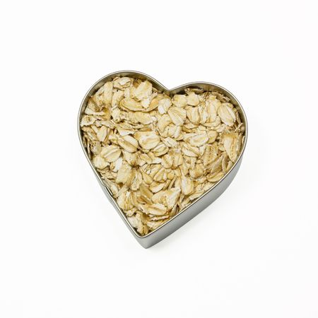 oatmeal: heart filled with oatmeal Stock Photo