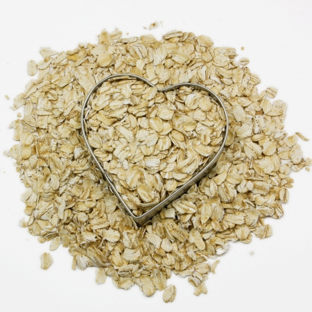 heart filled with oatmeal surrounded by oatmeal Banco de Imagens