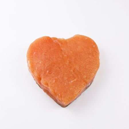 heart shaped salmon fillet on a white background photo