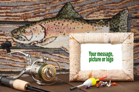 Reel, pole bobbers, jig on table with fish in background. White picture in birch frame can be changed to fit designers requirements. photo