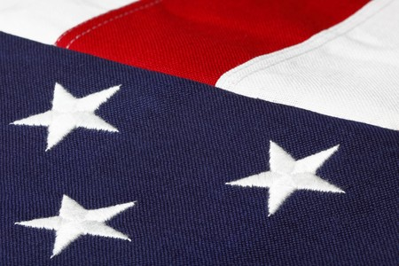 three embroidered stars of the american flag with red and white strips