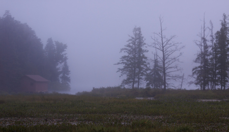 A mysterious fog rolls in from the lake to envelope a secluded boathouse.