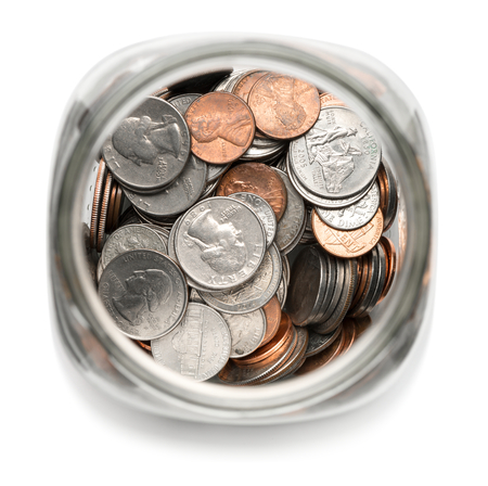 frugal: Glass Jar of Coins Stock Photo