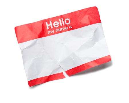 tag: Crumpled Hello Name Tag on White
