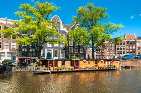 Houseboat on Amsterdam Canal Фото со стока