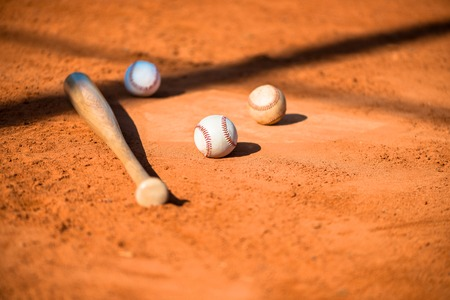 pitchers mound: Baseballs and Bat on Home Plate Stock Photo