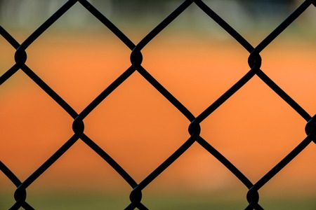 dugout: Close Up Chain Link Fence at Baseball Field Stock Photo