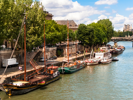 Houseboats on the Seine River in Paris, France