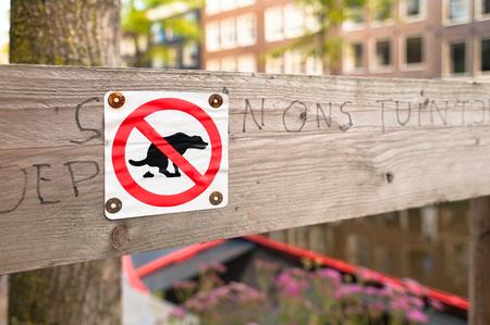 defamation: No Dog Poop Sign
