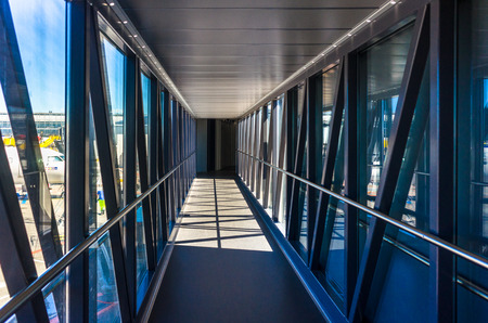 Jetbridge heading from airline terminal gate to airplane Фото со стока - 42925377
