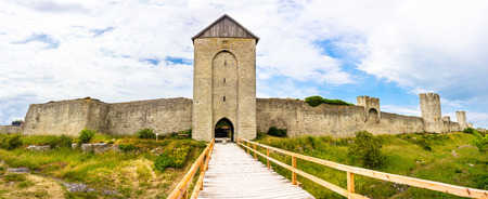 Turretted city wall Visby Sweden, Gotland with walkway to entrance Фото со стока