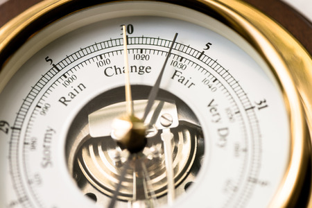 aneroid: Close up of aneroid barometer with needle at 30.3 inches