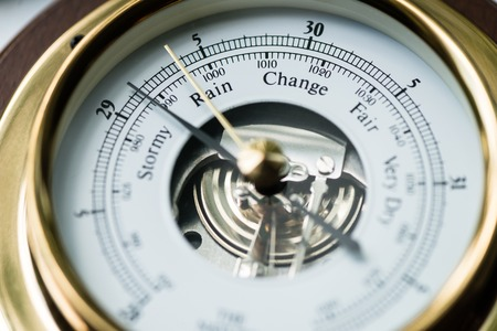 aneroid: Close up of aneroid barometer with needle at 29.13 inches