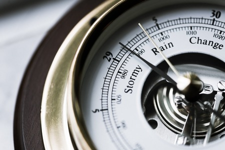 aneroid: Close up of aneroid barometer with needle at 29.125 inches Stock Photo