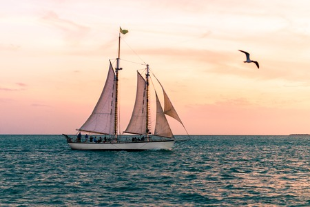 schooner: Tourists watch the sunset from a schooner off of Key West