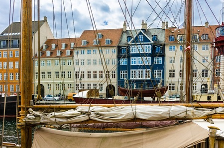 Popular tourist attraction, Nyhavn -New Harbor- with many boats, restaurants and tourists
