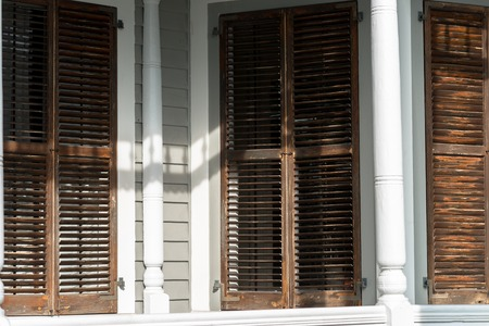 Weather worn shutters on a traditional Key West house