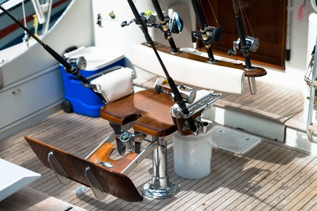 sportfishing: Fighting chair on sportfishing yacht with rods and reels Stock Photo