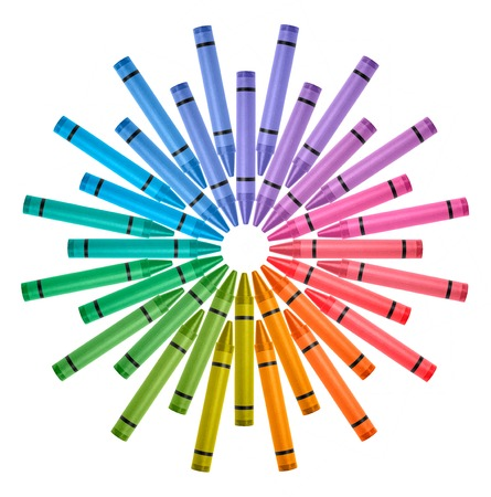 Photograph crayons arranged in circle color wheel on white  Фото со стока