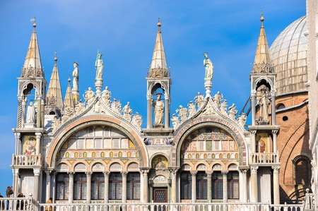 Close up detail of Saint Marks Basilica in Venice, Italy with tourists Фото со стока