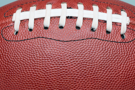 professional football: American professional football extreme close up on laces Stock Photo